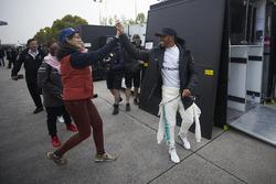 Lewis Hamilton, Mercedes AMG, high fives a fan