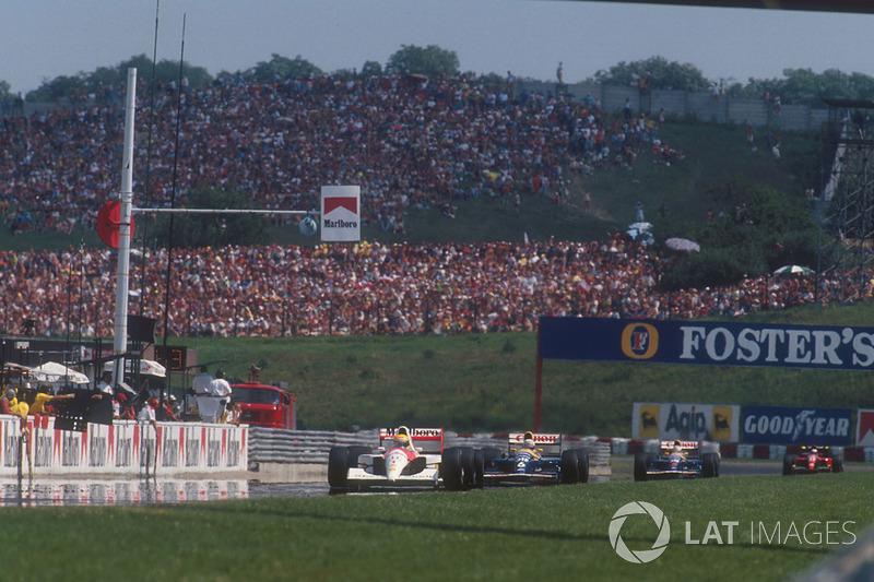 Ayrton Senna, McLaren MP4/6 Honda leads Nigel Mansell, Williams FW14 Renault, Riccardo Patrese, Williams FW14 Renault and Alain Prost, Ferrari 643