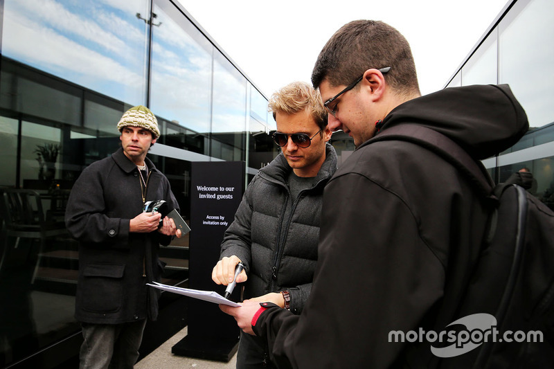 Nico Rosberg signs autographs for the fans