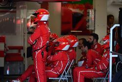 Ferrari mechanics in the garage