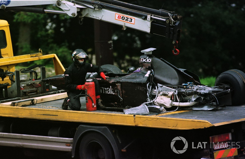 The wreckage of the Mika Salo, Arrows is bought back to the pits after his crash