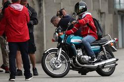 Sebastian Vettel, Ferrari arrives on a Suzuki 750 motor bike