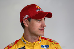 Joey Logano, Team Penske Ford, stands in the garage area