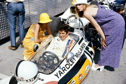 Brian Redman, McLaren M19A Ford, in the pits with fashion models