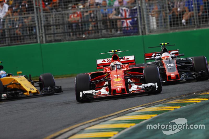 Kimi Räikkönen, Ferrari, SF70H; Kevin Magnussen, Haas F1 Team, VF-17; Jolyon Palmer, Renault Sport F