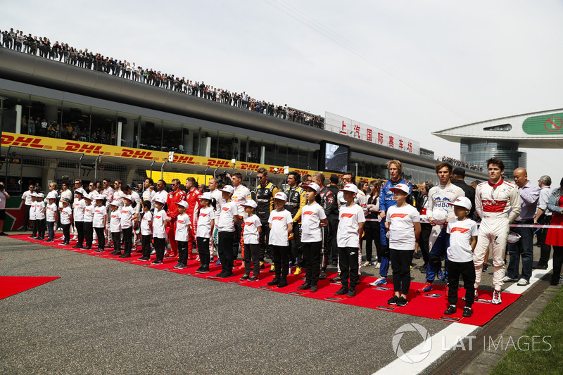 The drivers on the grid with mascots