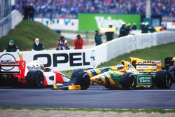 Ayrton Senna, McLaren MP4/7A Honda is taken out by Michael Schumacher, Benetton B192 Ford at the Ade