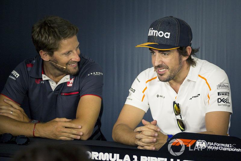 Romain Grosjean, Haas F1 y Fernando Alonso, McLaren