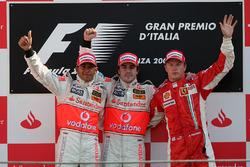 Podium: race winner Fernando Alonso, McLaren, second place Lewis Hamilton, McLaren and third place Kimi Raikkonen, Ferrari