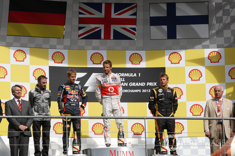 Podium: race winner Jenson Button, McLaren, second place Sebastian Vettel, Red Bull Racing, third place Kimi Raikkonen, Lotus F1