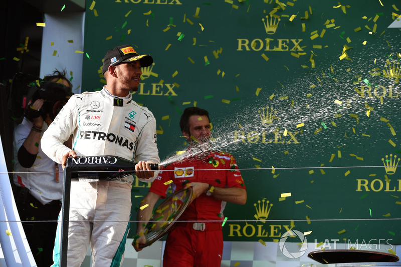 Lewis Hamilton, Mercedes-AMG F1 celebrates on the podium with the champagne