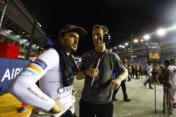 Fernando Alonso, McLaren, talks to his race engineer