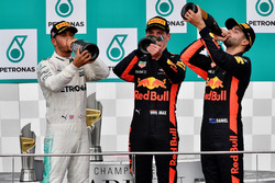 Lewis Hamilton, Mercedes AMG F1, Max Verstappen, Red Bull Racing and Daniel Ricciardo, Red Bull Racing celebrate on the podium, the champagne