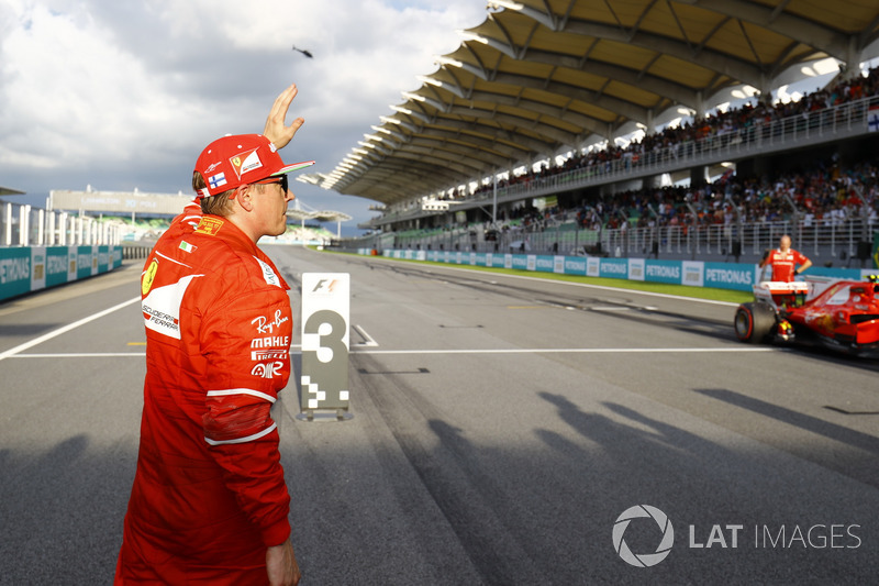 Kimi Raikkonen, Ferrari, waves to fans after qualifying second
