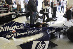 A young fan sits in a Juan Pablo Montoya BMW Williams