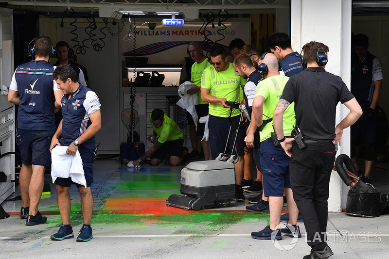 Williams mechanic clear aero paint from the garage floor