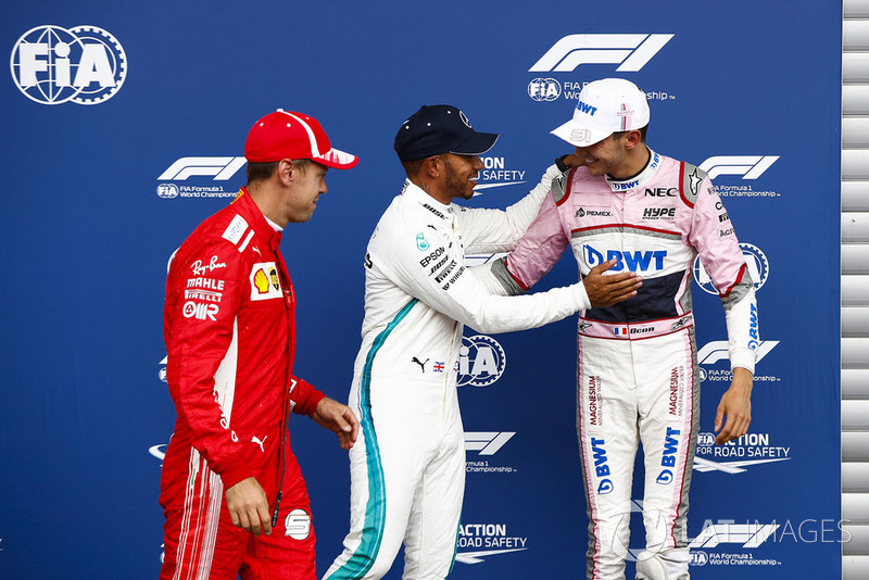 Sebastian Vettel, Ferrari, with Esteban Ocon, Racing Point Force India VJM1, and pole sitter Lewis Hamilton, Mercedes AMG F1