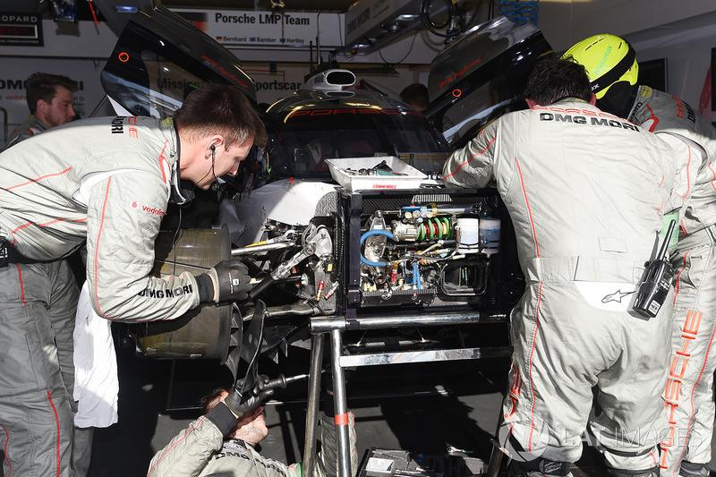 Crew members work on the #2 Porsche Team Porsche 919 Hybrid: Timo Bernhard, Earl Bamber, Brendon Hartley