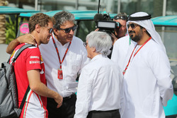 Sebastian Vettel, Ferrari con Pasquale Lattuneddu, y FOM and Bernie Ecclestone