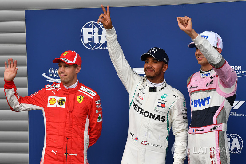 (L to R): Sebastian Vettel, Ferrari, Lewis Hamilton, Mercedes AMG F1 and Esteban Ocon, Racing Point Force India F1 Team celebrate in parc ferme