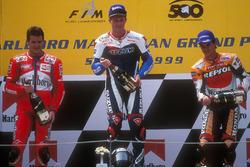 Podium: race winner Mick Doohan, second place Carlos Checa, third place Alex Criville