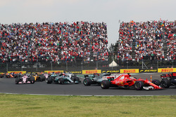 Sebastian Vettel, Ferrari SF70H and Lewis Hamilton, Mercedes-Benz F1 W08  clash at the start of the race