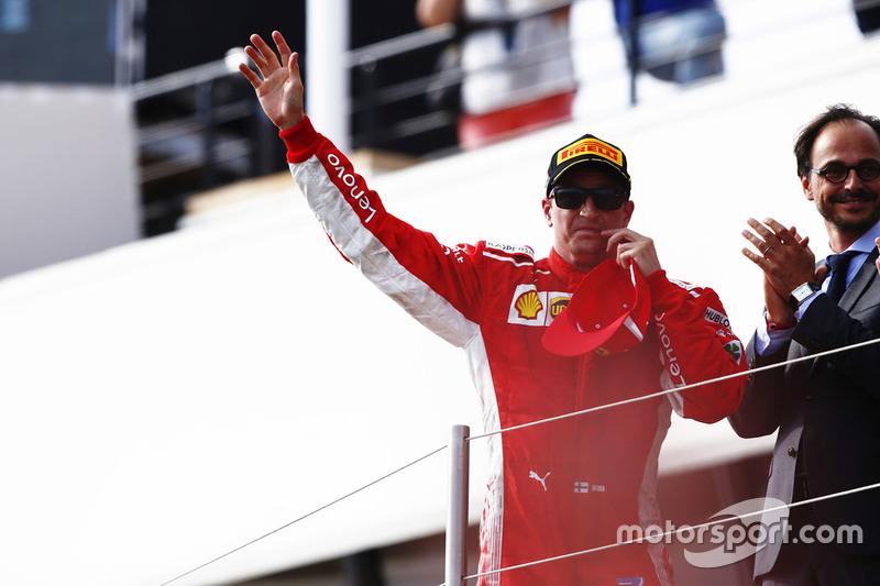 Kimi Raikkonen, Ferrari, celebrates on the podium