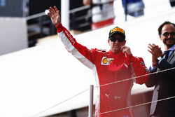 Kimi Raikkonen, Ferrari, celebrates on the podium