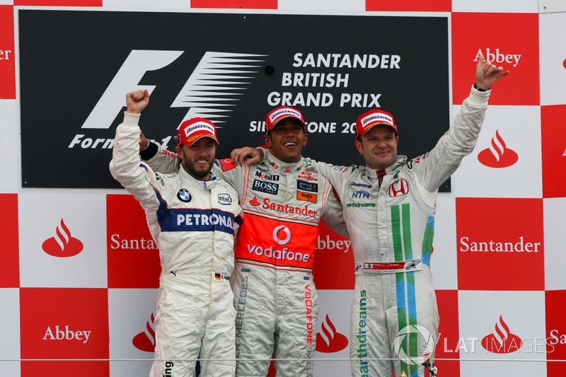 Podium: second place Nick Heidfeld, BMW Sauber F1, Race winner Lewis Hamilton, McLaren, third place Rubens Barrichello, Honda Racing F1 Team