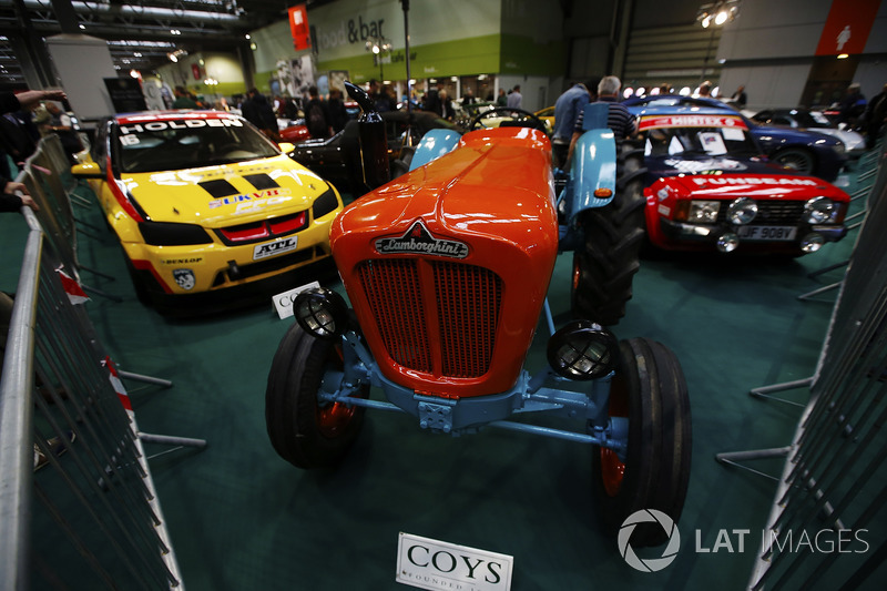 A Lamborghini tractor among cars on display at the Coys auction