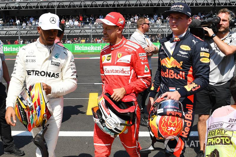 Lewis Hamilton, Mercedes AMG F1, pole sitter Sebastian Vettel, Ferrari and Max Verstappen, Red Bull Racing in parc ferme