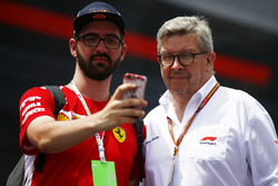 Ross Brawn, Managing Director of Motorsports, FOM, poses for a selfie with a fan
