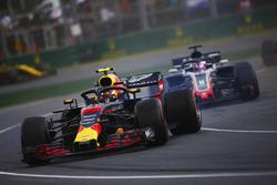 Max Verstappen, Red Bull Racing RB14 Tag Heuer, spins ahead of Romain Grosjean, Haas F1 Team VF-18 F