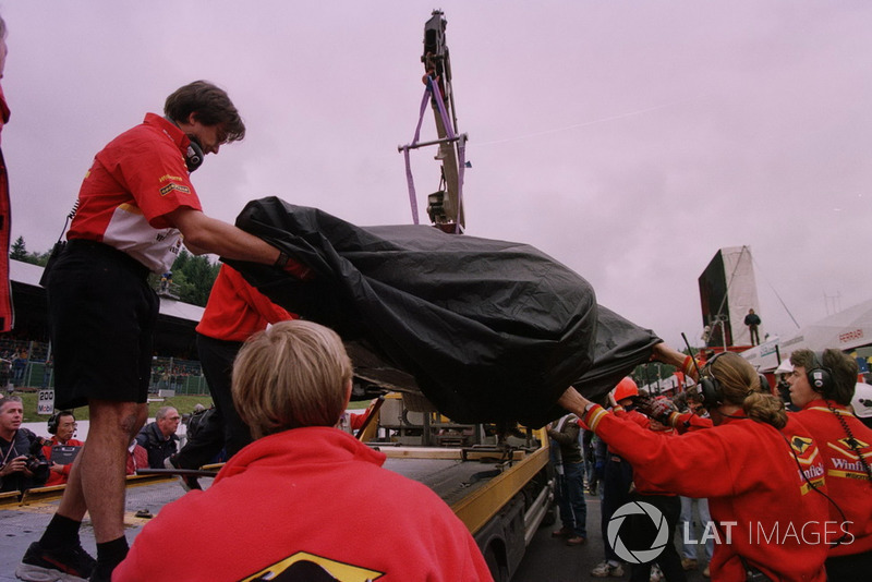 The wreckage of Jacques Villeneuve, Williams is bought back to the pits after his crash