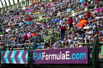 Fans watch the race from the grandstand