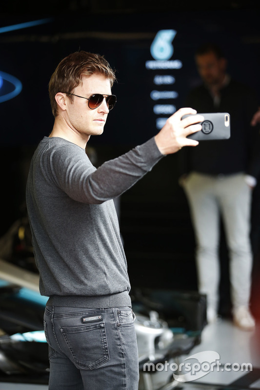 Nico Rosberg takes a selfie in the pit lane