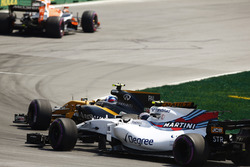 Jolyon Palmer, Renault Sport F1 Team RS17., passes Lance Stroll, Williams FW40