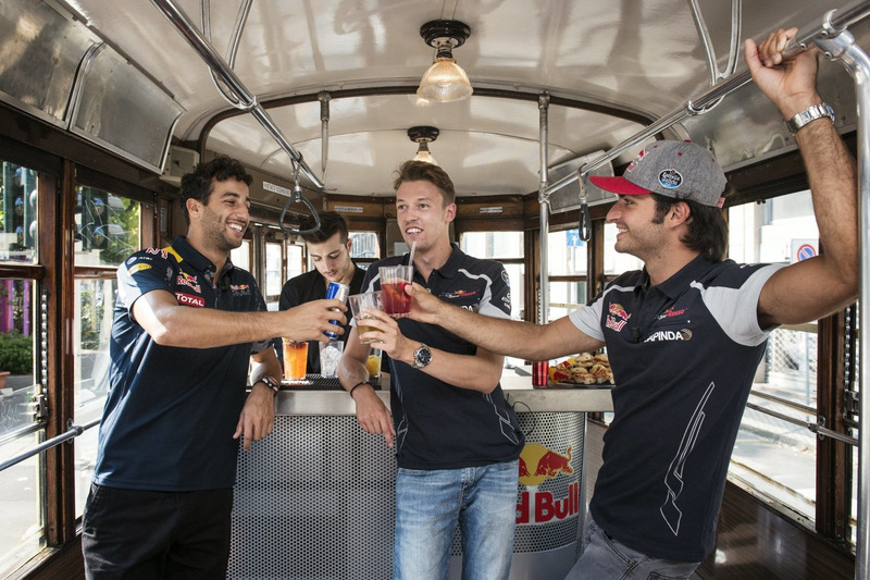 Daniel Ricciardo, Carlos Sainz Jr. and Daniil Kvjat enjoy their aperitivo on the historical tram of Milano