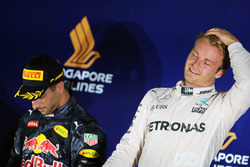 Race winner Nico Rosberg, Mercedes AMG F1 (Right) celebrates on the podium with second placed Daniel