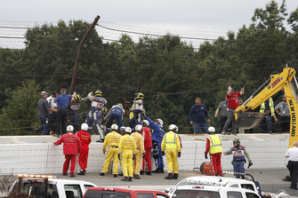 IndyCar officials at the site of the crash