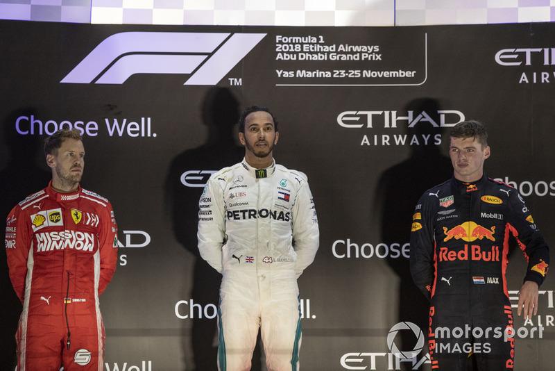 Podio: segundo lugar Sebastian Vettel, Ferrari y tercer lugar Max Verstappen, Red Bull Racing celebran