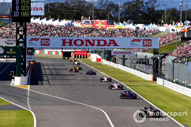 Romain Grosjean, Haas F1 Team VF-18 y Pierre Gasly, Scuderia Toro Rosso STR13