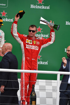 Kimi Raikkonen, Ferrari celebrates on the podium with the trophy