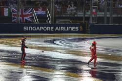 Kimi Raikkonen, Ferrari and Max Verstappen, Red Bull Racing walk in after crashing at race start