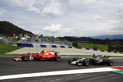 Kimi Raikkonen, Ferrari SF70H, battles Daniel Ricciardo, Red Bull Racing RB13 as Romain Grosjean, Haas F1 Team VF-17