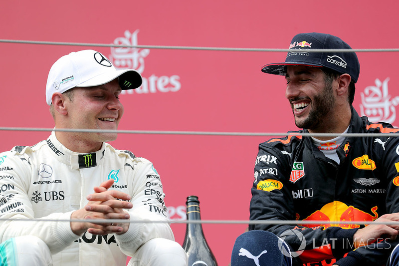 Race winner Valtteri Bottas, Mercedes AMG F1 celebrates on the podium, Daniel Ricciardo, Red Bull Racing