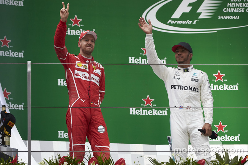 Podium: second place Sebastian Vettel, Ferrari, and Race winner Lewis Hamilton, Mercedes AMG, on the