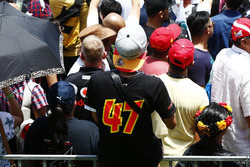 Fans watch the events on the F1 stage