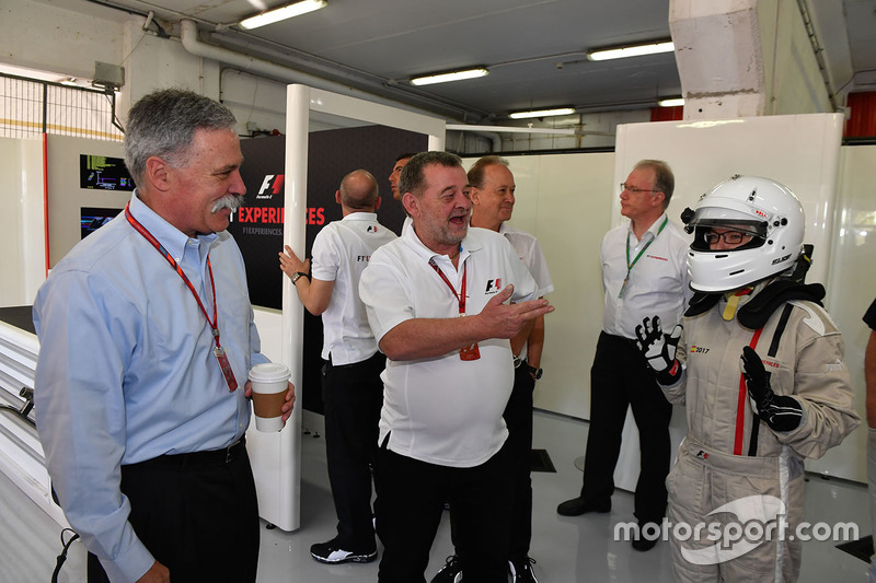 Chase Carey, Chief Executive Officer and Executive Chairman of the Formula One Group, Paul Stoddart,