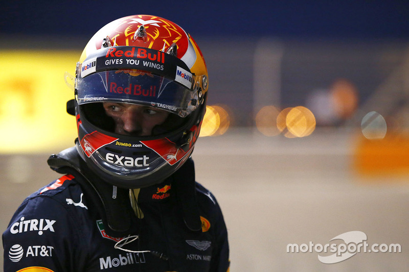 Max Verstappen, Red Bull Racing, climbs out of his car after retiring